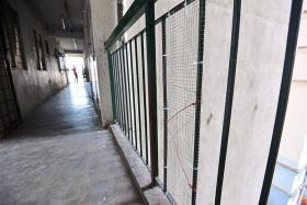 Wire mesh used to close off a gap in a railing at a flat in Malaysia.