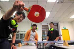 BANG: (From left) Singapore Polytechnic students Kendrick Hu, Douglas Wong and Daryl Heng with the Ballistic Accelerator Device.