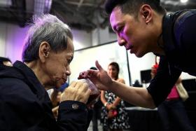A SON'S LOVE: Mr John Ryan Ting serves his signature drink to his mother, Madam Magdalene Tan, who suffers from lung cancer.