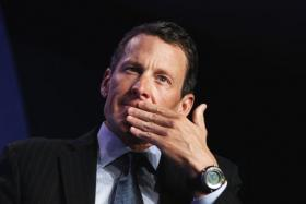 Lance Armstrong seen here in a file photo is involved in a hit-and-run in Aspen.