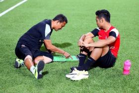"""""""It is very important for us to win our first match, at home, to hit the ground running. We also want to send our fans home with smiles after watching an entertaining game."""" - Fandi Ahmad (far left, giving Sahil Suhaimi some pointers)"""