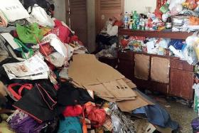 STILL DIRTY: Her flat was piled from floor to ceiling with hoarded items when the authorities first arrived.