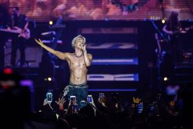SEXY: Singer Taeyang started the concert with his shirt on, but it came off after a few songs (above).