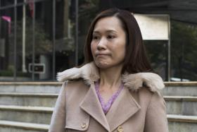Law Wan-tung, former employer of Indonesian domestic helper Erwiana Sulistyaningsih, leaving the district court in Hong Kong on Jan 8, 2015