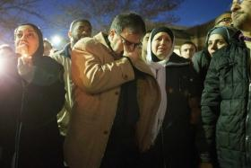 Namee Barakat (2nd L) and his wife Layla (3rd R), parents of shooting victim Deah Shaddy Barakat, react as a video is played during a vigil on the campus of the University of North Carolina in Chapel Hill.