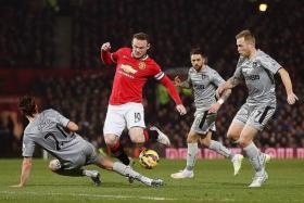 VERSATILE SKIPPER: Man United captain Wayne Rooney (in red) getting challenged by Burnley's George Boyd as he finds himself deployed as a defensive midfielder.