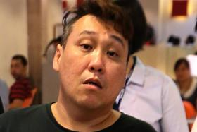 NABBED: Mr Frankie Tan (above), the owner of Double Ace Associates, and his employees have been arrested for unlawful assembly. They will be charged today.