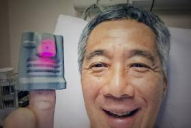 This photo of PM Lee Hsien Loong at SGH was taken after the prostate biopsy that detected the cancer.