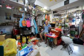 DIY PROJECTS: Mr Yee is fond of installing hooks to hang his bags and clothes.