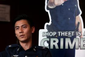 IN THE FLESH: (Above) Meet ASP Ryan Koh, the man from the standee, which has become a popular online meme.
