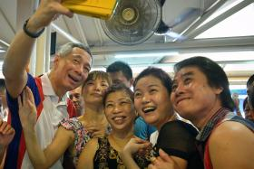 SELFIE: Prime Minister Lee Hsien Loong at an event in Ang Mo Kio on Saturday.