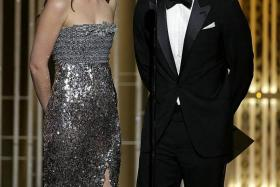 FIRE AND ICE: Actors Dakota Johnson and Jamie Dornan were steamy in Fifty Shades of Grey, but kept an awkward distance at the Golden Globes (above).