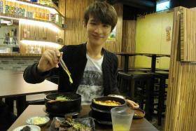 HEARTY: Local singer-songwriter Reuby having lunch at Korean eatery Ajumma's, at The Cathay.