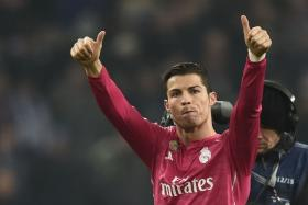 Real Madrid's Portuguese forward Cristiano Ronaldo reacts after the last 16, first-leg UEFA Champions League football match FC Schalke 04 vs Real Madrid in Gelsenkirchen, western Germany on February 18, 2015. Real Madrid won 0-2.