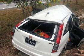 TRAGIC: The family of five was travelling to Perak when the father apparently lost control of the car.
