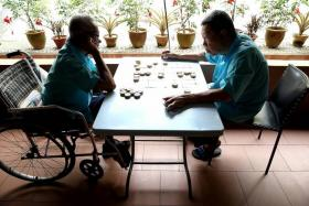 LONELY: Mr Lim Ah Hin (left) and Mr Lim Ah Lee (right) have both been living at the Silra Home for more than 12 years.