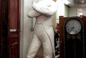 OLD GEMS: A statue of Sir Stamford Raffles (above) stands in the warehouse of Hock Siong & Co. The company, which buys items from defunct hotels sees a fair share of walk-in customers who pick out furniture for their homes.