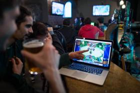 "Gamers take part in a Hearthstone tournament at the ""e-sport"" Meltdown bar in north London on February 14, 2015."