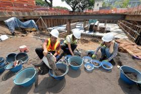 Volunteers for NSC-ISEAS have to work fast as urban development is encroaching on the excavation site.