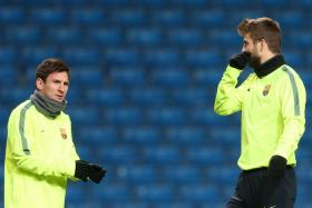 Barcelona's Lionel Messi and Gerard Pique in training.