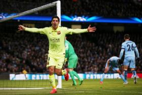 Luis Suarez celebrates after scoring for Barcelona against Manchester City in the Champions League.