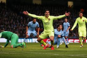Luis Suarez celebrates after scoring the second goal for Barcelona  in Champions League Second Round First Leg against Manchester City