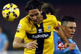Parma players like Alessandro Lucarelli (in yellow) must do their own laundry because of the team's money woes.