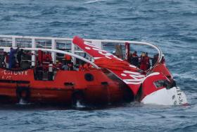File photo of an Indonesian search and rescue ship recovering the tail wreckage of AirAsia flight QZ8501 from the seabed south of Borneo island on Jan 10.