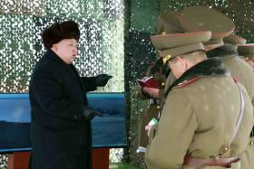 This undated picture released from North Korea's official Korean Central News Agency (KCNA) on Feb 21 shows North Korean leader Kim Jong-Un (L) inspecting a drill for striking and seizing island at an undisclosed location in North Korea.