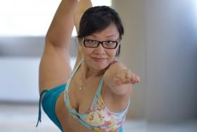 BALANCE AND CONTROL: Ms Diane Lee showing one of the 26 postures in Bikram yoga - the Standing Bow Pulling Pose.