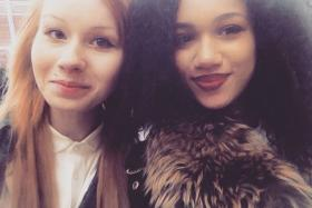 Double take: Lucy (left) and Maria (right) Aylmer made the news for being an extremely rare set of fraternal or non-identical twins - one white and one black - who still have trouble convincing people they are sisters, much less twins.