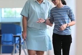 DETERMINED: With her friend, Miss Teh Sook Hu.