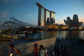 Thrillist website mentions how Singapore's skyline is graced by an illuminated ferris wheel and the world's most expensive building, Marina Bay Sands, which cost US$5.7 billion.