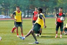 HARD AT WORK: Madhu Mohana (centre) is unhappy with the LionsXII defence which has conceded seven goals in three matches.