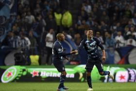 Porto's midfielder Casimiro (right) celebrates after scoring the third goal