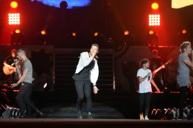 One Direction's concert on Wednesday night (March 11) was the most tweeted about Singapore-based event - setting a new record with more than 100,000 tweets.