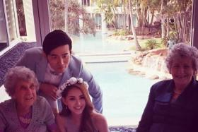 I'll bring the wedding to you: Filial Jay Chou (standing) held three weddings, one in North Yorkshire, England, one in Taipei, Taiwan, and one in Gold Coast, Australia (above) because his and wife Hannah Quinlivan's (front, centre) grandparents were unable to travel from their home countries.