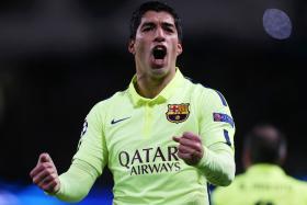 Luis Suarez celebrates after scoring against Manchester City in the Champions League