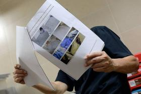RESOLVED: (Above) Mr Tan showing photographs he used as evidence for mediation, such as the the corrosive agent that destroyed his clothes.