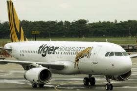 A KL to S'pore flight was delayed for two hours after a Tigerair stewardess spotted what turned out to be a prosthetic finger.