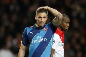 Arsenal's French striker Olivier Giroud reacts during the UEFA Champions League football match Monaco vs Arsenal, on March 17 in Monaco.