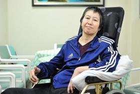 BIG HEART: Workers' rights campaigner Bridget Tan, who suffered a stroke last year, now moves around in a wheelchair.