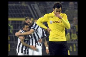 Hummels of Borussia Dortmund reacts after the second goal of Tevez of Juventus during their Champions League round of 16 second leg soccer match in Dortmund.