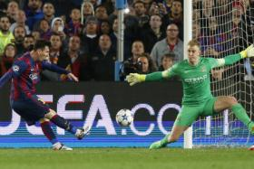 Manchester City's Joe Hart saves from Barcelona's Lionel Messi.