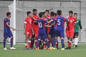 CLASH: Singapore's U-23s (in red) in a confrontation with the Cambodia U-22s during the match at Jalan Besar Stadium yesterday.