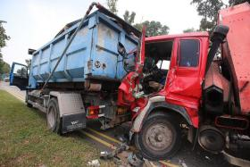 CRASH: An industrial lorry collided with the rear of a tipper truck yesterday morning in Woodlands.