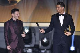 Cristiano Ronaldo hands a microphone to Lionel Messi  after being selected to the 2014 FIFA FIFPro World XI during the FIFA Ballon d'Or award ceremony in January this year