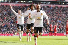 Juan Mata celebrates scoring the second goal for Manchester United.