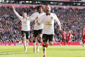 Juan Mata celebrates scoring the second goal for Manchester United.