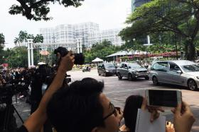 The hearse carrying the body of Mr Lee Kuan Yew arriving at Istana.
